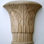 A wood Egyptian-style capital, inspired by those at the temple at Isna. Hand-carved by Agrell Architectural Carving.