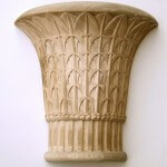 A wood Egyptian-style capital, inspired by those at the temple at Philae. Hand-carved by Agrell Architectural Carving.