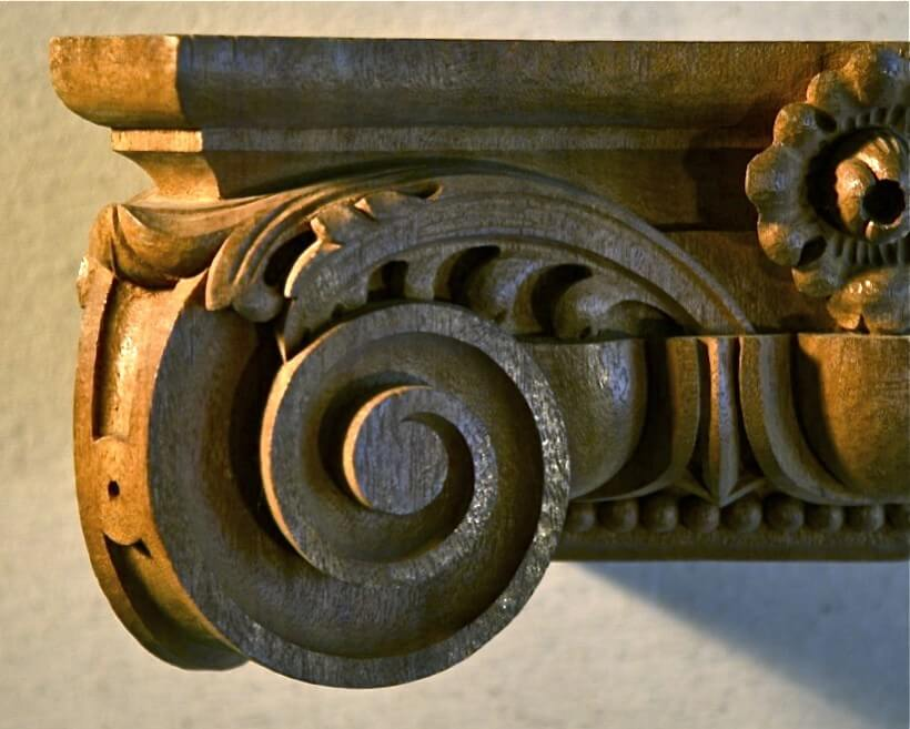 An Ionic-style capital hand-carved in wood by Agrell Architectural Carving.