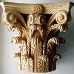 A Corinthian-style capital hand-carved in wood by Agrell Architectural Carving
