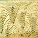 Art Deco-style panel featuring wheat and hand-carved in wood by Agrell Architectural Carving.