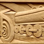 Art Deco train panel based on a Robert Mallard Stevens design and hand-carved in wood by Agrell Architectural Carving.