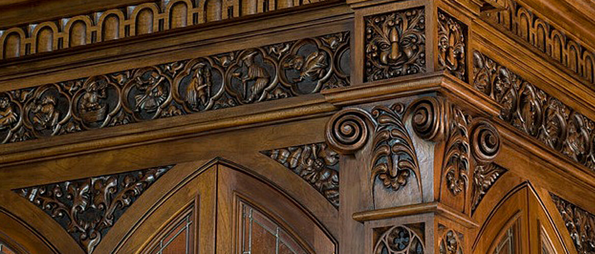 Detail from a private bar designed by Mark Cravotta and hand-carved by Agrell Architectural Carving.