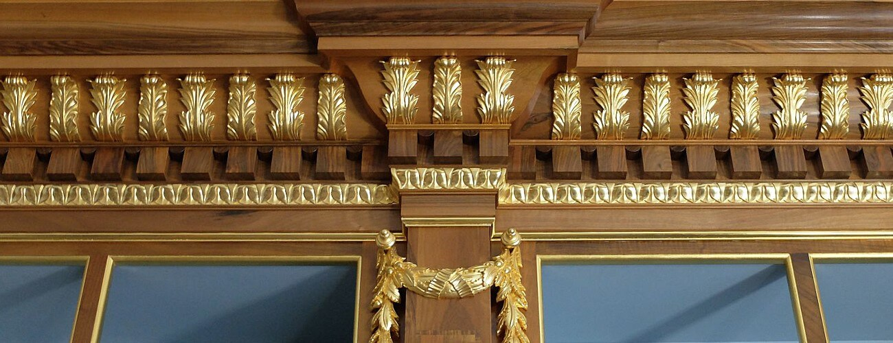 Baroque-style library with woodcarving by Agrell Architectural Carving and millwork by Artichoke Ltd of England