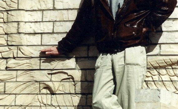 Ian Agrell supervises the installation of a brick wall sculpture in Eagle County, Colorado.