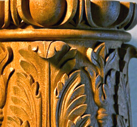 Detail of a hand-carved wood capital by Agrell Architectural Carving.