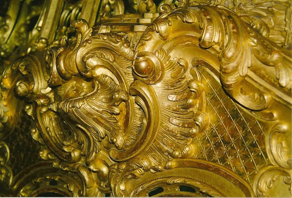 Detail of a gilded Rococo fire surround