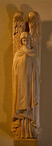 Hand-carved in wood by Agrell Architectural Carving.