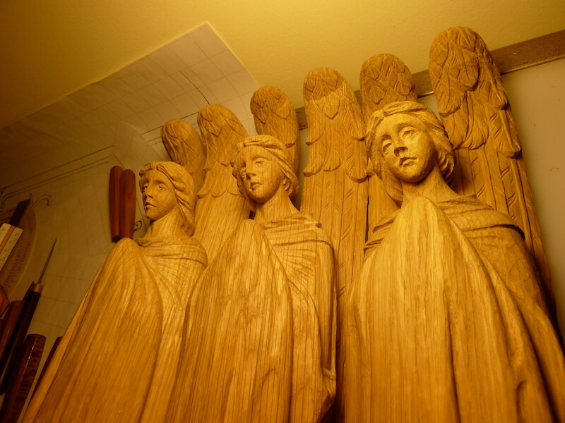 Hand-carved in white oak by Agrell Architectural Carving.