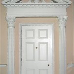 Door surround with Corinthian capitals and a split pediment