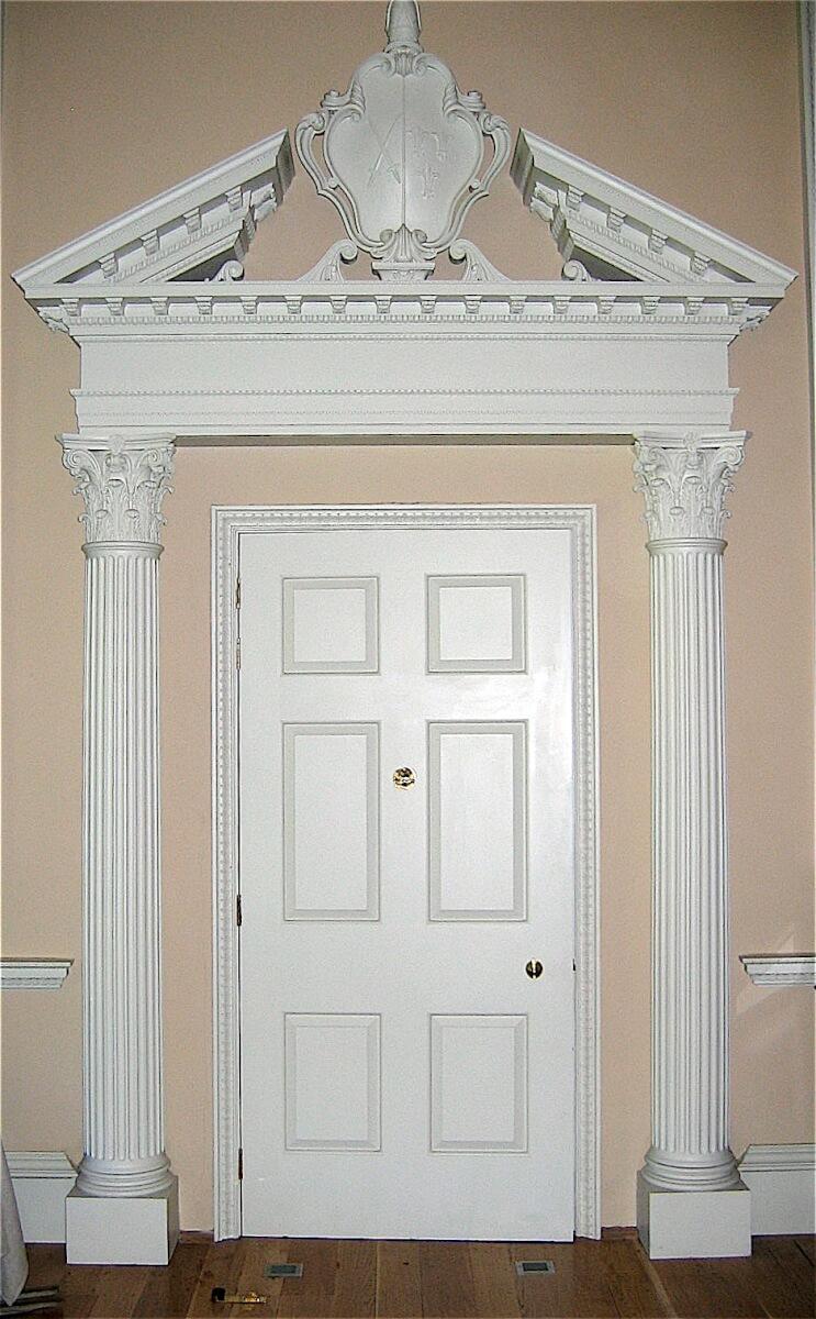 Door surround with Corinthian capitals and a split pediment