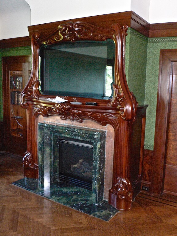 Art Nouveau fire surround, designed and hand-carved in mahogany by Agrell Architectural Carving.