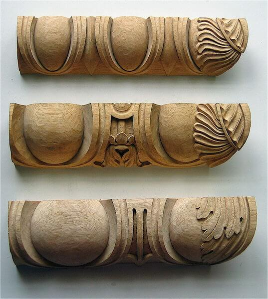 Wood-carved egg and dart mouldings, each demonstrating the correct way to add an acanthus motif on the miters. By Agrell Architectural Carving.