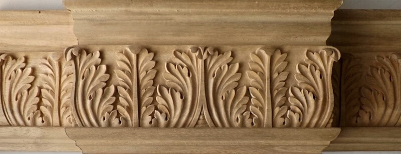 Wood-carved acanthus cornice moulding by Agrell Architectural Carving.