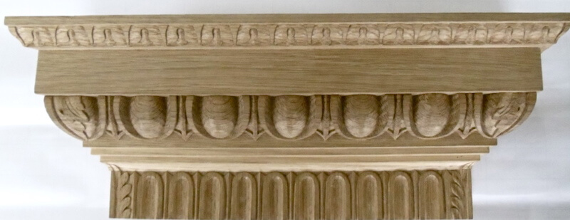 Lamb's tongue, egg and dart, and fluting mouldings assembled as a pilaster capital. By Agrell Architectural Carving.
