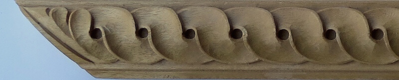 Wood-carved interlaced guilloche moulding by Agrell Architectural Carving.