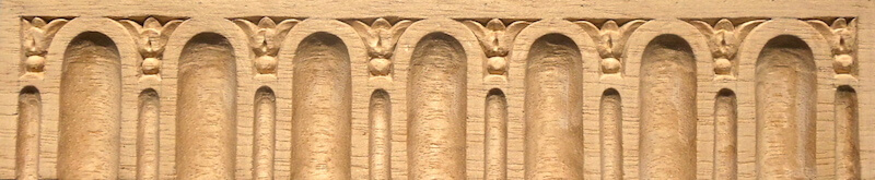 Wood-carved fluting and bellflower moulding by Agrell Architectural Carving.