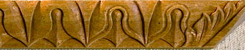 Wood-carved lamb's tongue moulding by Agrell Architectural Carving.
