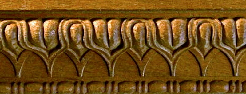 Wood-carved Roman-style lamb's tongue moulding with bead and reel, based on a design found at the Temple of Mars Ultor. By Agrell Architectural Carving.
