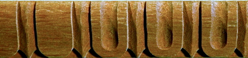 Wood-carved fluted moulding with darts by Agrell Architectural Carving.