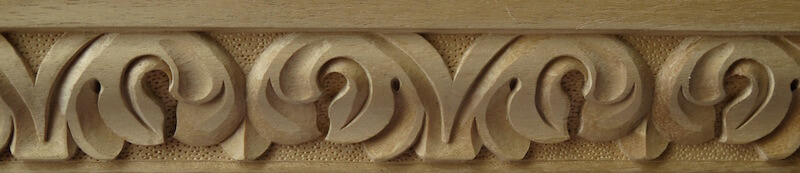 Wood-carved acanthus moulding with stippled background by Agrell Architectural Carving.