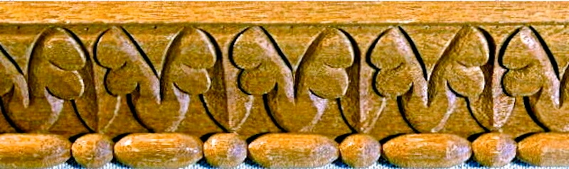 Wood-carved acanthus and bead moulding by Agrell Architectural Carving.