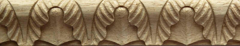 Wood-carved lamb's tongue moulding with variegated leaves by Agrell Architectural Carving.