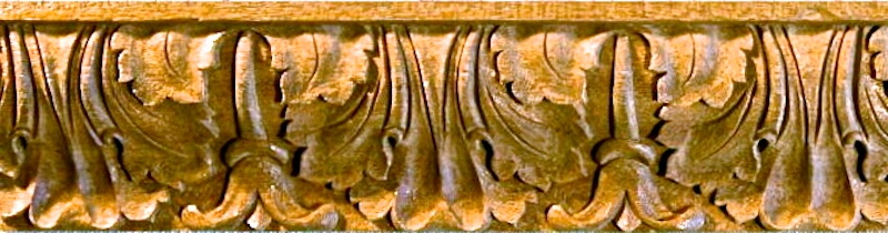 Wood-carved acanthus and bellflower moulding by Agrell Architectural Carving.
