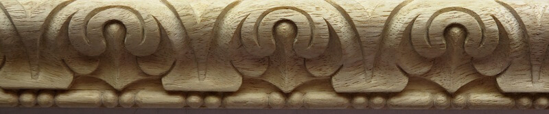 Wood-carved lamb's tongue-style acanthus moulding with sausage and bead. By Agrell Architectural Carving.