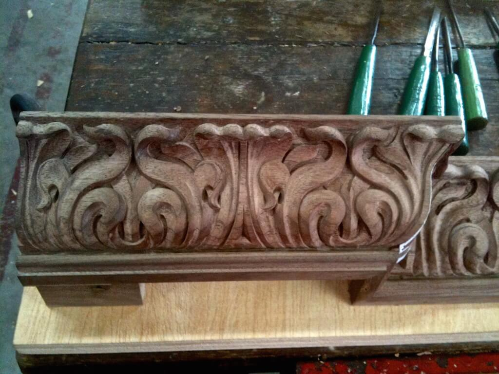 Art Nouveau cyma recta moulding, designed and hand-carved in walnut by Agrell Architectural Carving.