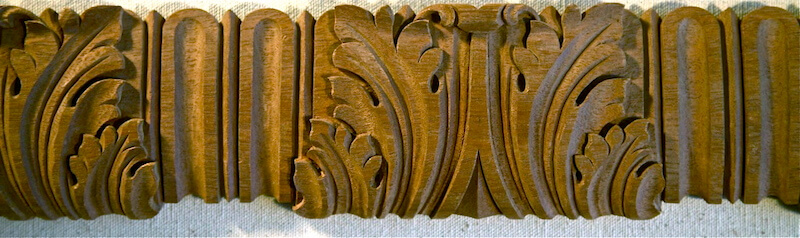 Wood-carved acanthus and flute moulding by Agrell Architectural Carving.