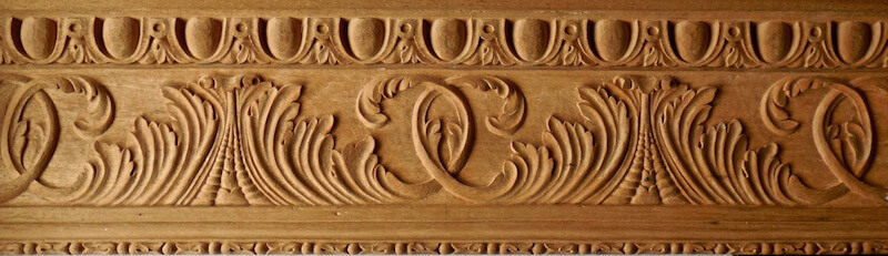 Egg and dart, acanthus, and bellflower mouldings based on woodcarvings found at Leed's Castle in England.