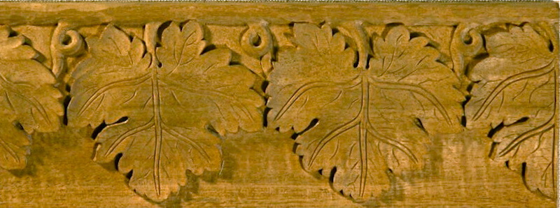 Wood-carved grapevine moulding by Agrell Architectural Carving.