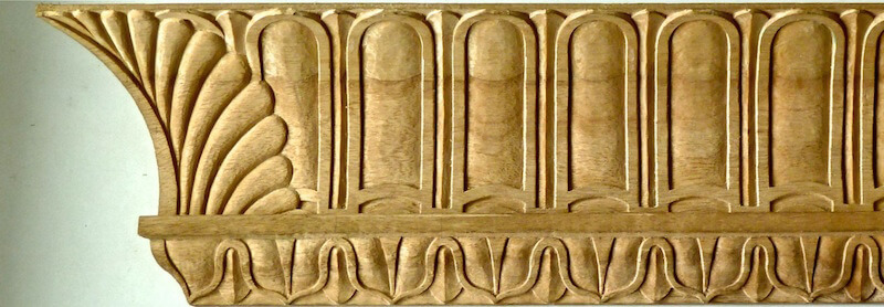 Wood-carved neoclassical cavetto moulding paired with a lamb's tongue motif. By Agrell Architectural Carving.
