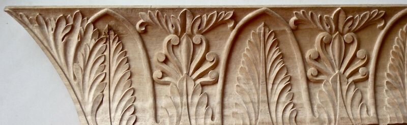 Wood-carved neoclassical moulding with acanthus leaves and honeysuckle by Agrell Architectural Carving.