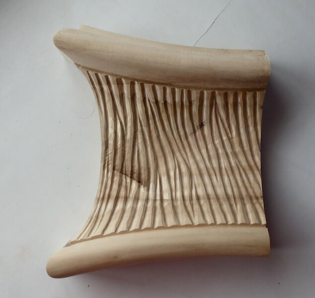 Wood-carved textured cavetto moulding by Agrell Architectural Carving.