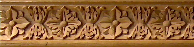 Wood-carved Italian-style cavetto moulding by Agrell Architectural Carving.