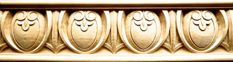 Elaborate wood-carved egg and dart moulding by Agrell Architectural Carving.