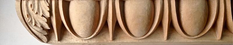 Wood-carved egg and dart moulding by Agrell Architectural Carving.