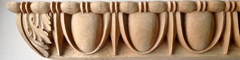 Wood-carved egg and dart moulding with matching bead and reel by Agrell Architectural Carving.