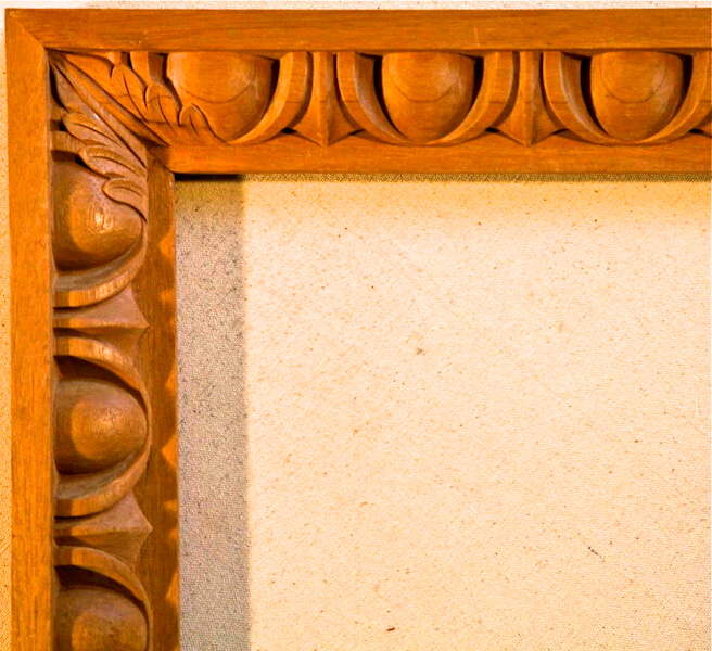 Wood-carved egg and dart moulding demonstrating the correct treatment of a miter. By Agrell Architectural Carving.