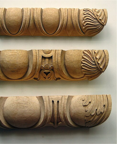 Egg and dart mouldings that demonstrate the correct way of applying an acanthus motif to a miter. By Wood-carved x moulding by Agrell Architectural Carving.