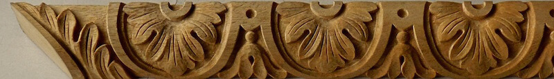 Wood-carved neoclassical moulding featuring flowers and bellflowers. By Agrell Architectural Carving.