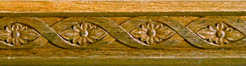 Wood-carved flower and fret moulding by Agrell Architectural Carving.