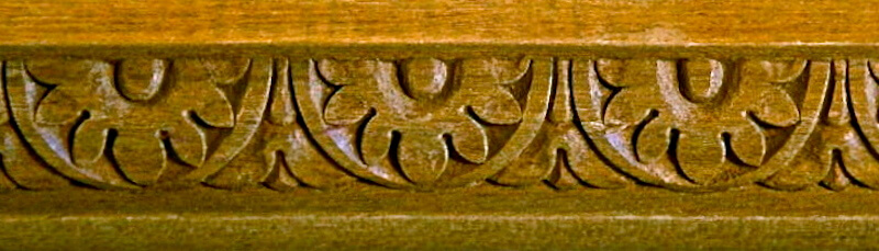 Wood-carved neoclassical-style moulding with sunflowers and bellflowers by Agrell Architectural Carving.