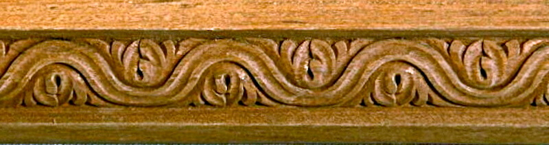 Wood-carved ovolo moulding by Agrell Architectural Carving.