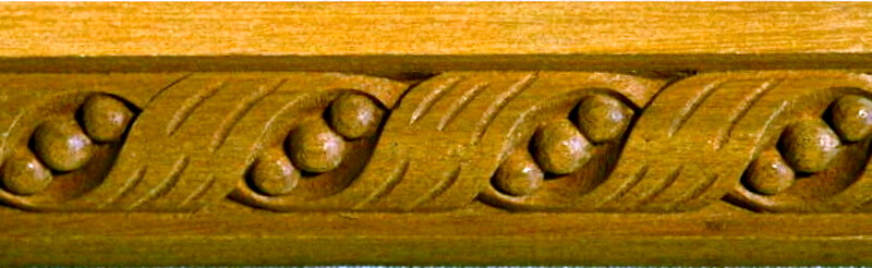 Wood-carved ribbon and bead moulding by Agrell Architectural Carving.