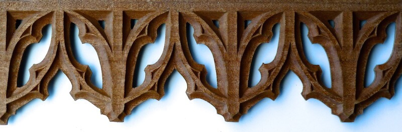 Wood-carved pierced Gothic tracery by Agrell Architectural Carving.