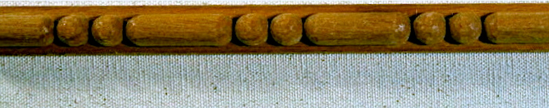 Wood-carved sausage and bead moulding by Agrell Architectural Carving.