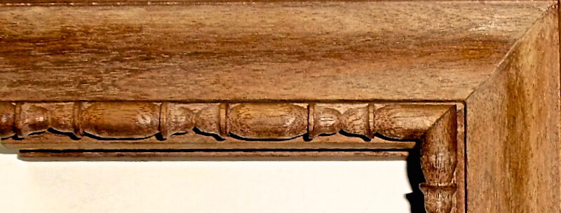 Wood-carved sausage and reel moulding by Agrell Architectural Carving.